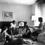 Family watching television in 1958