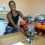 Woman unpacks sewing machine