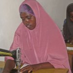 Somali woman sews sanitary pads in production room