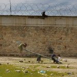 Two children play among deplorable conditions a the Pul-e Charkhi prison in Kabul, 2008