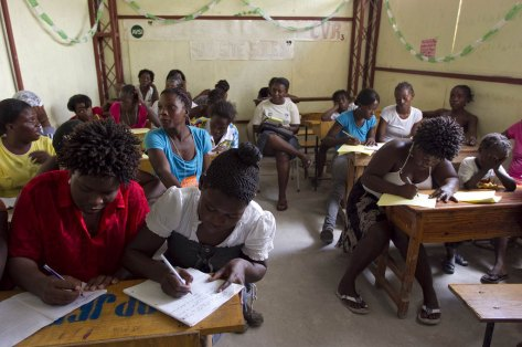 Women learn to read and write in a classroom in Cité Soleil, Haiti. Image: Logan Abassi/MINUSTAH