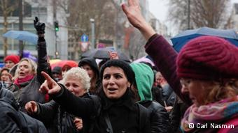 Women's rights activists stage flash mobs across Germany