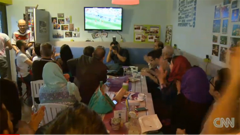 Defying ban, Iranian women watch World Cup with men in public