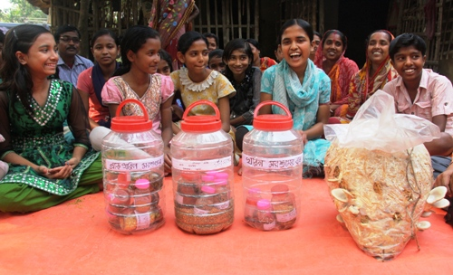 Girls show their special sustainable seeds during a training in farming.