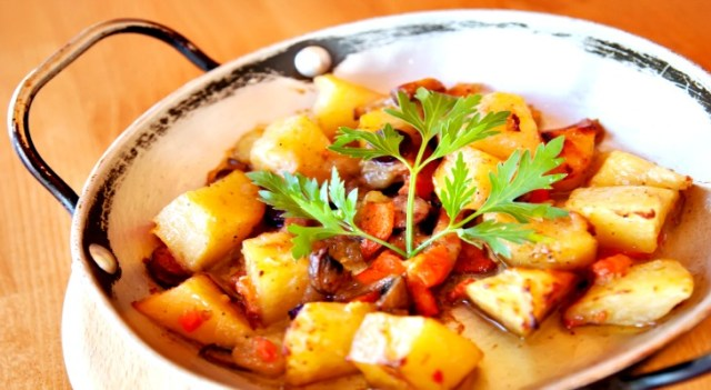 Vegetable ragout with potato, carrot and mushrooms