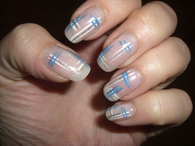Gel nails are basically the extensions to your natural nails. These are very much in common and in trend due to the overall delicate and beautiful look they give to your hands. They are made up of gel like material which itself is dried up with the help of ultra violet light or may be light emitting diode. Gel nails last for approximately ten to twelve days. They are expensive to buy. Gel nails are treated as manicure treatment. How to apply Gel nails on your nails: Applying Gel nails on your nails is not a tough job to do. It is also not a time taking task. In doing so, gel is applied to the nails which hardens under ultra violet light. Sometimes light emitting diode is also used. Let us see step by step how are they actually applied. Steps: 1. Before applying gel nails, prepare your nails for the new look. Cut your nails and give them shape. You can give them any shape like round, almond or square. After this, file your nails. Your Gel nails are going to be just look like your natural nails. 2. Now when you are having the well-defined shape of nails, make use of cuticle remover near the base (skin) of your nails. 3. After this, apply a thin coat as a base layer on your nails. Make sure that it is a thin layer and wait till it dries up. 4. When you feel that the first layer has been dried up, apply the second layer which is also extremely thin. This layer will be called as your color gel. Apply this layer on the tip of your nail as well. You have to keep your nails (after applying each layer) under ultra violet light for two to three minutes. 5. Coat your nails now with the top gel and apply the gel on tip of the nails too. Again keep them for two or three minutes under UV light. 6. Remove the gel if the gel material is present on other than your natural nails. Things to remember while applying Gel nails: • Gel nails don't take much time to apply; they enhance the look of your hands. • The shiny look that Gel nails will give, won't disappear soon. At least for two weeks, your nails are going to shine. • The gel polish that is used in Gel nails may be bad for the health of your natural nails. • Gel nails may cause weakening of your natural nails. • The light used in the drying of gel, may even cause cancer. It depends upon salon to salon how much intensity of light it use. • When applying Gel nails, your hands are also exposed to the light which may harm your hands too. • Though Gel nails are considered as a part of manicure but still the process of getting them off from your nails after some days may be painful. • You have to use acetone solution to remove them and acetone solution can cause dehydration.