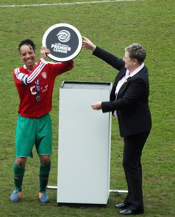 Coventry United Ladies captain Natasha Lynch holding aloft the FAWPL Plate trophy