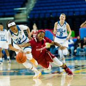 Bruin point guard Jordin Canada and Cardinal point guard Lili Thompson battle for the ball. Photo by Percy Anderson.