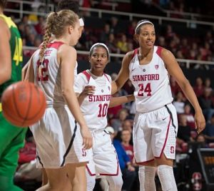 Briana Roberson and Erica McCall confer with teammates during a timeout. Photo by Mike Rasay/StanfordPhoto.com