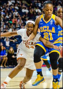 Ariel Atkins (24) and Nirra Fields (21) fight for a loose ball. Photo by Robert L. Franklin.