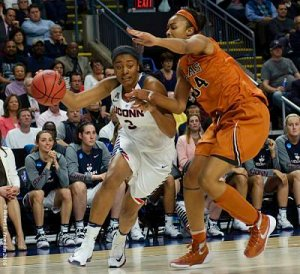 UConn's Morgan Tuck (3) pump fakes and then drives the baseline on Texas's Imani Boyette (34) to score. Photo by Robert L. Franklin.
