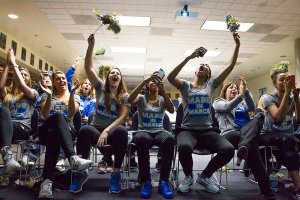 UCLA players and coach Cori Close rejoice at their third seed during Selection Monday. Photo courtesy of UCLA Athletics.