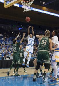 Jordin Canada scores on the fadeaway in the fourth quarter. Photo by William Johnson/T.G.Sportstv1.