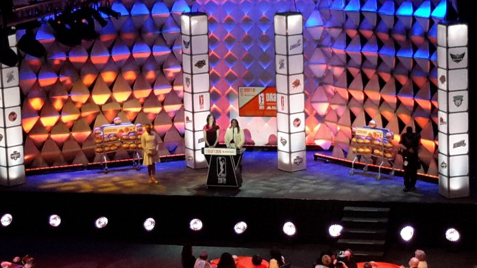 Rebecca Lobo and Sheryl Swoopes open the draft, and put the Seattle Storm, with the first pick, on the clock. Photo by Rebecca Rider.