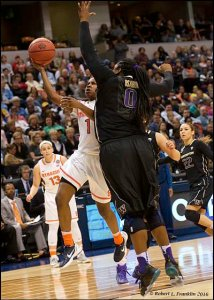 Alexis Peterson goes up past Chantel Osahor. Photo by Robert L. Franklin.