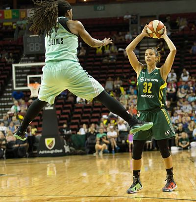Alysha Clark looks to pass around a high-flying Shavonte Zellous. Photo by Neil Enns/Storm Photos