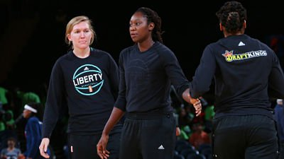 Carolyn Swords and Tina Charles of the New York Liberty warm up before their game against the Indiana Fever Thursday at Madison Square Garden in New York, New York. The WNBA had announced the Liberty would be fined for altering team warm ups. Charles responded by turning her warm up shirt inside out. Photo by Mike Stobe/NBAE via Getty Images.