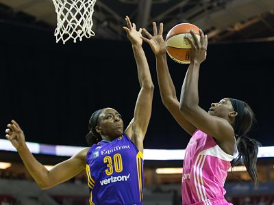 Sparks forward Nneka Ogwumike tries to stop Crystal Langhorne's shot Friday. Photo by Neil Enns/Storm Photos.