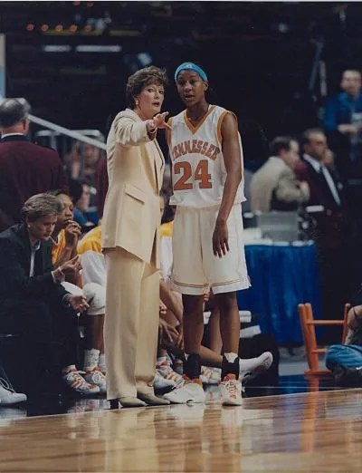 Pat Summitt and Tamika Catchings discuss strategy during a game. Photo courtesy of Tennessee Athletics.