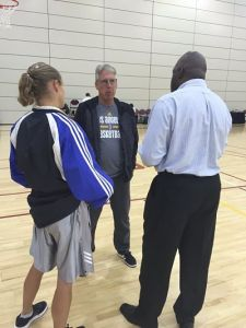 Sue Favor of womenshoopsworld.com and LT Willis of TG Sports TV talk with Sparks coach Brian Agler after the first day of training camp on April 24, 2016. Photo by Los Angeles Sparks media relations.