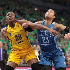 Maya Moore fights for position against Nneka Ogwumike. Photo by Jordan Johnson/NBAE via Getty Images.