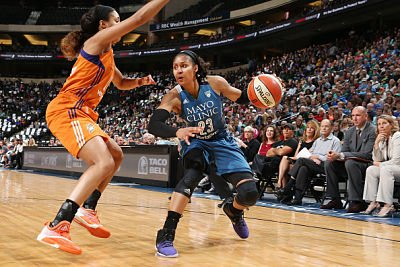 Maya Moore handles the ball en route to 26 points on the night. Photo by David Sherman/NBAE via Getty Images.