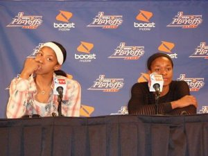 Candace Parker and Alana Beard listen to a question in a press conference after losing in the Western Conference Finals in 2012. Photo by Sue Favor.