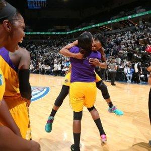 Jantel Lavender hugs Alana Beard after the win. Photo by David Sherman/NBAE Getty Images.
