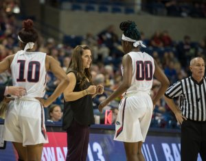 Coach Lisa Fortier meets with Zykera Rice at a timeout. Photo by Mike Wootten, Gonzaga Athletics.