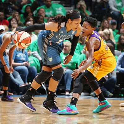 Maya Moore handles the ball against Alana Beard during WNBA Finals Game 5. Photo by David Sherman/NBAE via Getty Images.