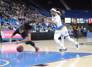Minyon Moore struggles for ball possession, as Jordin Canada is in pursuit. Photo by Benita West, TGTVSports1.