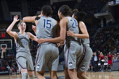 Katie Lou Samuelson, left, high-fives her teammates after the final buzzer Tuesday. Photo by Stephen Slade.