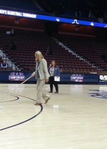 American Athletic Conference associate commissioner Barbara Jacobs swept the floor between rounds of the conference tournament. Photo by Jim Clark.