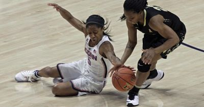 Connecticut's Crystal Dangerfield and UCF's Aliyah Gregory scramble for the ball. Photo by Steve Slade.
