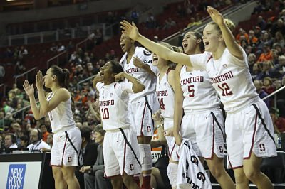 The Stanford bench erupts in the final seconds of Saturday's semifinal win. Photo by Eric Evans Photography)