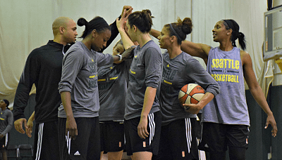 The Seattle Storm huddle up after the completion of the first day of training camp. Photo courtesy of Seattle Storm.