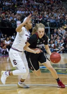 Brittany McPhee tries to beat the defense. Photo by Robert Franklin.