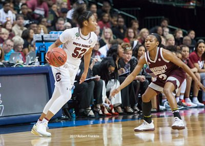 Tyasha Harris tries to get past Morgan William. Photo by Robert L. Franklin.