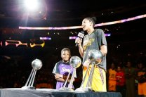 Candace Parker, with daughter Lailaa, addresses the Staples Center crowd after receiving her Championship ring. Photo by Maria Noble/WomensHoopsWorld.