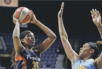 Jonquel Jones tries to shoot past Cheyenne Parker. Photo by Jessica Hill/AP.