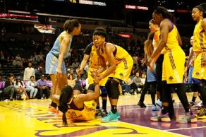 Sky center Imani Boyette and Sparks guard Alana Beard help Nneka Ogwumike to her feet after a foul. Photo by Maria Noble, WomensHoopsWorld.