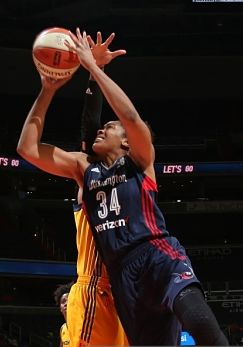 Krystal Thomas goes up for a shot. Photo by Ned Dishman/NBAE via Getty Images.