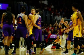 Candace Parker congratulates Diana Taurasi after she scored the basket to become the WNBA's all-time leading scorer. Photo by Maria Noble/WomensHoopsWorld.