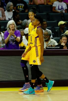 Candace Parker walks with Alana Beard to the Sparks trainer. Photo by Maria Noble/WomensHoopsWorld.