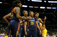 Connecticut Sun players react to a call. Photo by Maria Noble/WomensHoopsWorld.