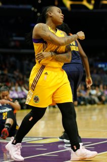 Riquna Williams pumps a fist after making a shot. Photo by Maria Noble/WomensHoopsWorld.
