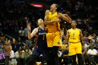 Candace Parker exults as her shot falls. Photo by Maria Noble/WomensHoopsWorld.