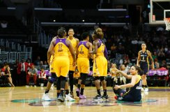 The Sparks convene at midcourt as Natalie Achonwa was fouled. Photo by Maria Noble/WomensHoopsWorld.