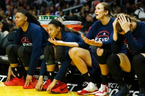 Fever reserves react in disbelief to a foul call. Photo by Maria Noble/WomensHoopsWorld.