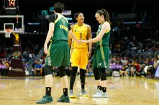 Candace Parker and Breanna Stewart share a laugh at a timeout. Photo by Maria Noble/WomensHoopsWorld.